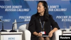 "FILE - Meng Wanzhou, chief financial officer of Chinese technology giant Huawei, attends a session of the VTB Capital Investment Forum ""Russia Calling!"" in Moscow, Russia Oct. 2, 2014."