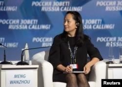 Tư liệu - Bà Mạnh Vãn Chu tham dự một diễn đàn về đầu tư ở Moscow, Nga, ngày 2 tháng 10, 2014.