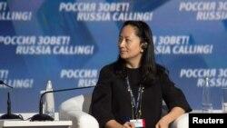 Bà Mạnh Vãn Chu dự một diễn đàn ở Nga năm 2014.