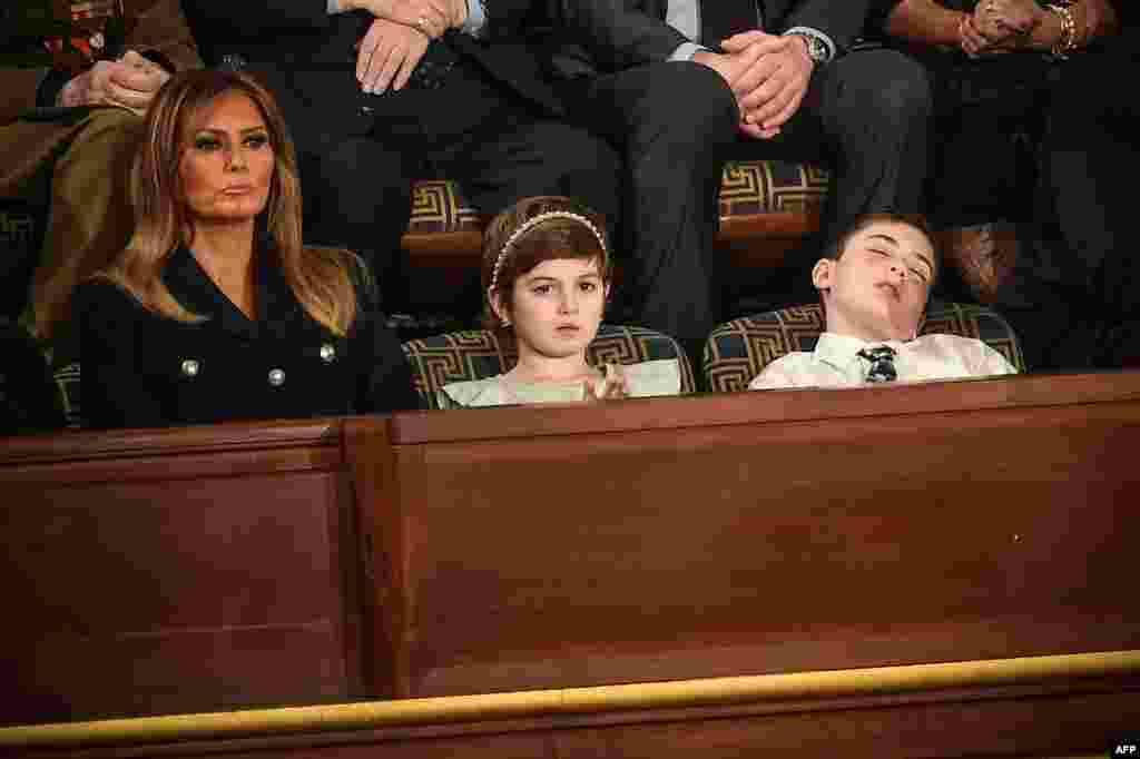 Special guest Joshua Trump falls asleep while U.S. First lady Melania Trump (L) and special guest Grace Eline listen to the State of the Union address at the U.S. Capitol in Washington, D.C., Feb. 5, 2019. Joshua is a sixth-grade student from Wilmington, Delaware, who has been bullied over his last name.