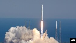 FILE - The SpaceX Falcon 9 rocket lifts off from launch complex 40 at the Kennedy Space Center in Cape Canaveral, Florida, Apr. 8, 2016. SpaceX said it expected to launch a Falcon 9 rocket from California's Vandenberg Air Force Base on Jan. 8 to put 10 satellites into orbit for Iridium Communications Inc.