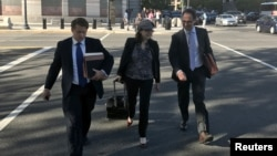 FILE - Kyle Freeny (C) and Andrew Weissmann (R), members of special counsel Robert Mueller's team of prosecutors probing potential ties between Russia and U.S. Presidential Donald Trump's 2016 campaign, leave court in Washington D.C., U.S., Sept. 29, 2017.