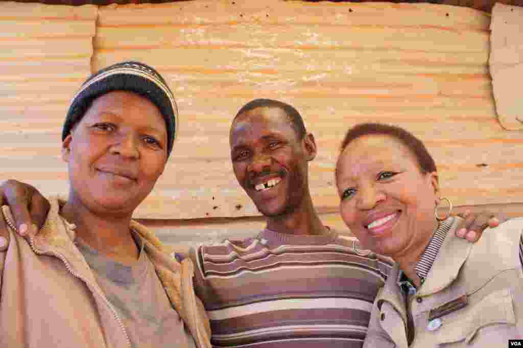 Mohalalelwa stands with his wife, Joyce (left) and Snowy Nkoana (right), a nurse he says saved his life. (Photo by Darren Taylor)