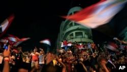 Opponents of Egypt's Islamist leader Mohamed Morsi celebrate outside the presidential palace in Cairo, July 3, 2013.