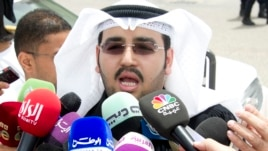 Laywer Ali al Ali speaks to the media in Kuwait City, June 16, 2013, after leaving the courthouse to announce the court's decision to dissolve parliament.