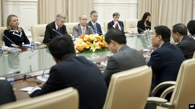 U.S. Secretary of State Hillary Rodham Clinton, left, listens to Chinese Foreign Minister Yang Jiechi, right, during their meeting at the Peace Palace in Phnom Penh, Cambodia, July 12, 2012.