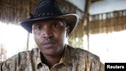 Indicted war criminal Bosco Ntaganda poses for a photograph during an interview in Goma, Democratic Republic of Congo, October 2010.