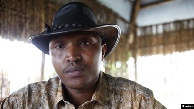 Indicted war criminal Bosco Ntaganda poses for a photograph during an interview with Reuters in Goma, Democratic Republic of Congo in 2010.