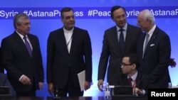 From left, Russian chief negotiator on Syria Alexander Lavrentyev, Iranian Deputy Foreign Minister Hossein Jaberi Ansari, Kazakh Foreign Minister Kairat Abdrakhmanov and U.N. Special Envoy for Syria Staffan de Mistura attend the fourth round of Syria peac