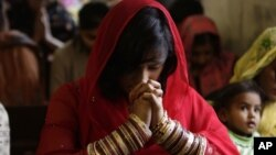 Pakistani Christians attend a prayer service on the first day of the New Year at a local church in Lahore, Pakistan, Wednesday, Jan. 1, 2014. (AP Photo/K.M. Chaudary)