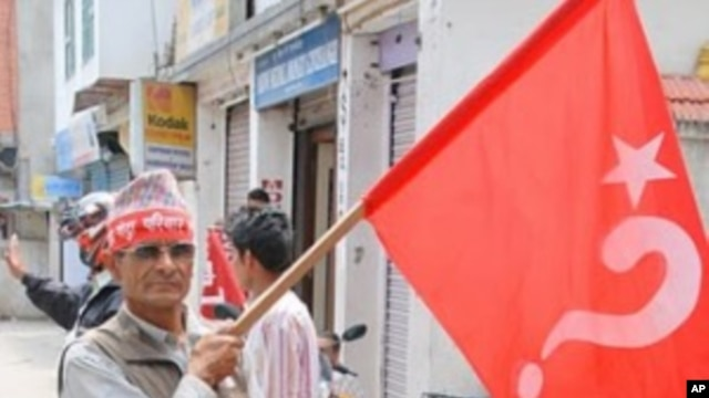Maoist supporter en route for a mass rally in central Kathmandu, 1 May 2010