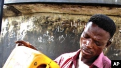 A roadside vendor pours fuel into a bottle in Lome (File)