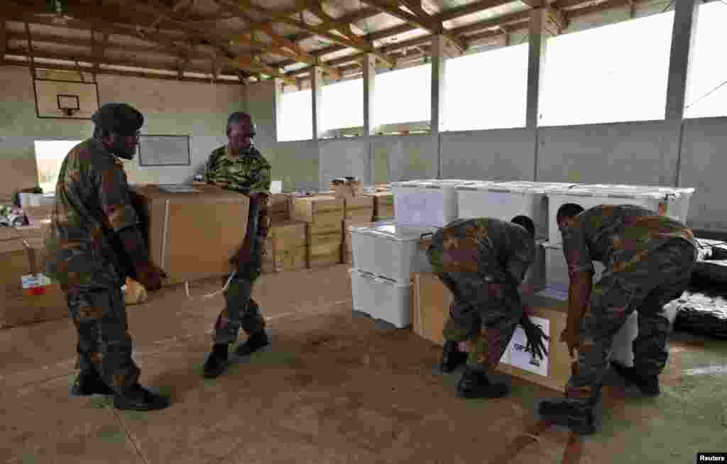 Vanuatu Mobile Force personnel unload generators from Australia days after Cyclone Pam in Port Vila, capital city of the Pacific island nation of Vanuatu, March 19, 2015.