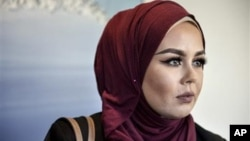 Norway fines hairdresser for refusing Muslim in hijab