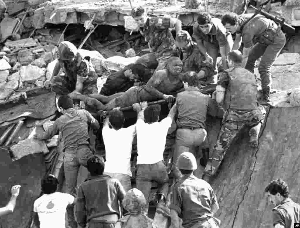 FILE - British soldiers help in rescue operations at the site of the bomb-wrecked U.S. Marine command center near the Beirut airport, Lebanon, Oct. 23, 1983.