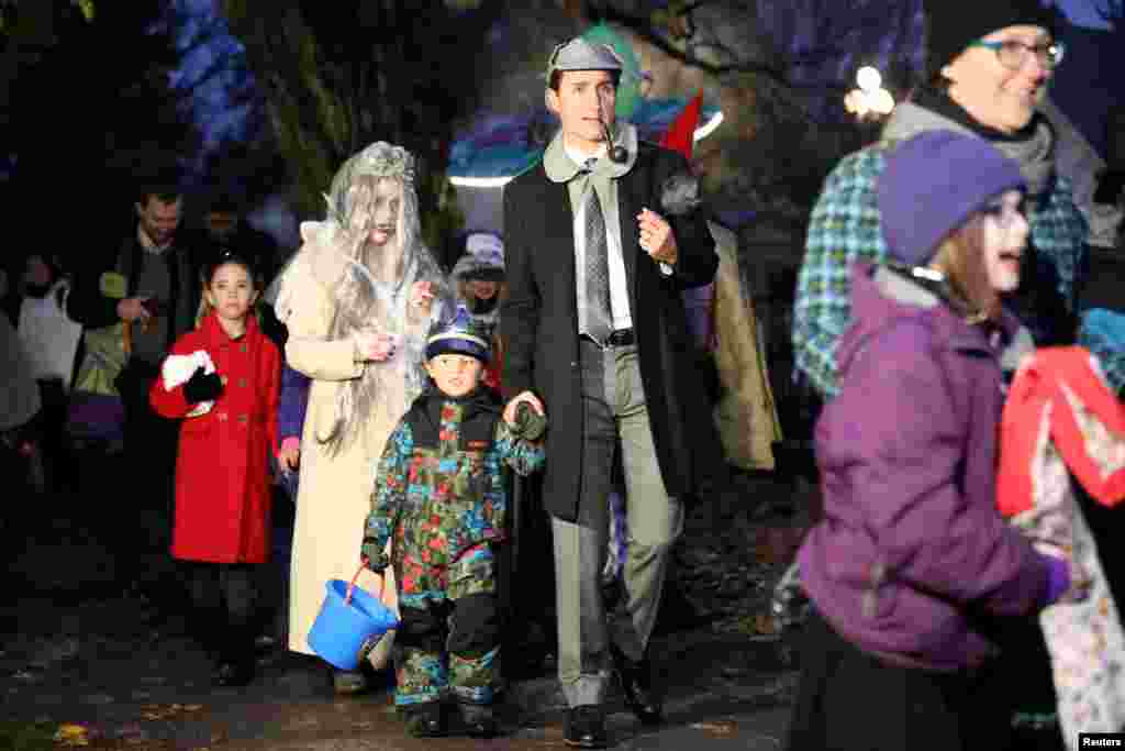 Canada's Prime Minister Justin Trudeau walks with his son Hadrien and family while participating in Halloween festivities at Rideau Hall in Ottawa, Ontario, Oct. 31, 2018.