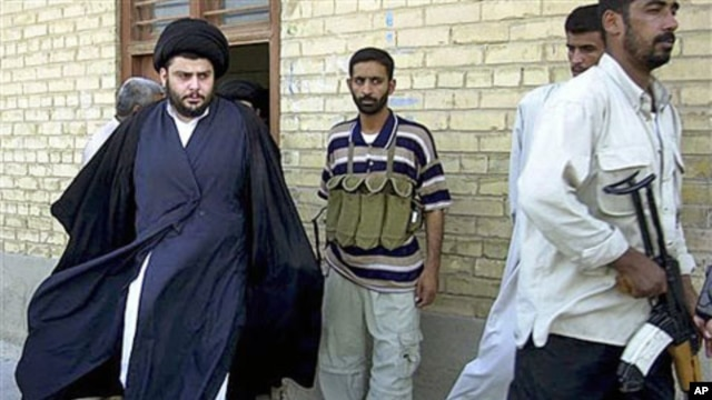 Shiite cleric Muqtada al-Sadr (L) - whose political party called December 26, 2011, for dissolution of Iraq's parliament and new elections in another move that could escalate country's growing sectarian crisis - steps from an office building in Najaf, Ira