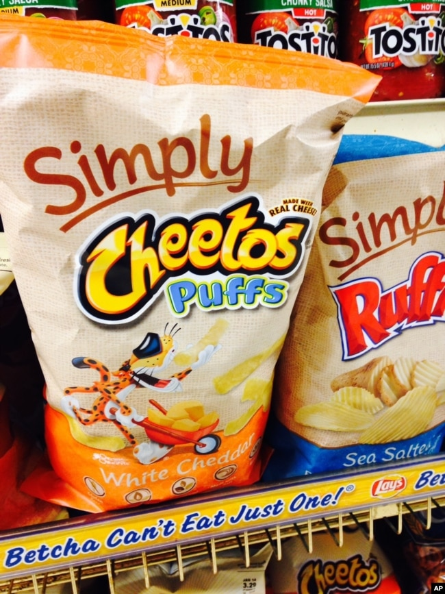 FILE - In this Jan. 24, 2014, file photo, Simply Cheetos are displayed in New York. Frito-Lay is opening a pop-up Cheetos-themed restaurant in New York City for three days beginning Tuesday, Aug. 15, 2017. (AP Photo/Candice Choi, File)