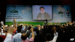 Hezbollah leader Sheikh Hassan Nasrallah speaks via a video link during a graduation ceremony in a southern suburb of Beirut, Lebanon, July 25, 2015.