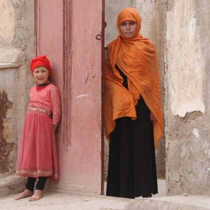Photo of Somaya standing in a doorway in Herat, Afghanistan.