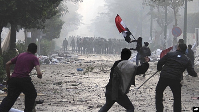 Egyptian protesters throw rocks and firebombs at military police during clashes near Cairo's downtown Tahrir Square, December 16, 2011.