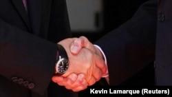S. President Joe Biden and Russia's President Vladimir Putin shake hands as they arrive for the U.S.-Russia summit at Villa La Grange in Geneva, Switzerland, June 16, 2021. REUTERS/Kevin Lamarque