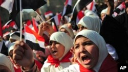 Egyptian women shout slogans in Cairo's Tahrir Square during celebrations marking one week after Egypt's long-time president Hosni Mubarak was forced out of office, February 18, 2011