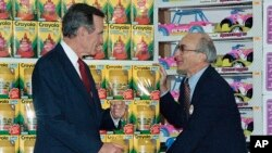 FILE - Toys R Us founder Charles Lazarus, right, speaks as President George H. Bush visits the toy chain's second store to open in Japan, Jan. 7, 1992.