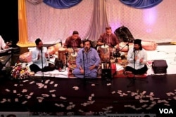 FILE - Amjad Sabri (C) performed at a Qawwali Concert in Annandale, Virginia, in 2013. Qawwali is a form of Sufi Devotional Music popular in South Asia, particularly in areas with a historically strong Muslim presence, such as Pakistan and parts of North India. (Saqib Ul Islam/VOA)