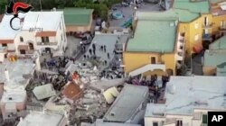 A collapsed building is seen in this aerial view of Casamicciola, on the island of Ischia, near Naples, Italy, a day after a 4.0-magnitude quake hit the Italian resort island, Aug. 22, 2017.