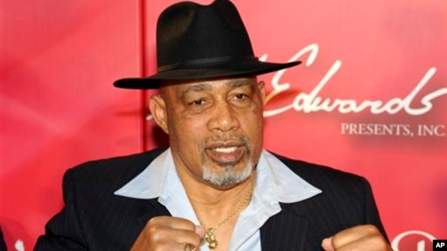 "FILE - Former heavyweight boxer Ken Norton poses on the red carpet at the ""Keep Memory Alive Gala"" fundraiser honoring Muhammad Ali's 70th birthday at the MGM Grand Garden Arena in Las Vegas, Feb. 18, 2012."