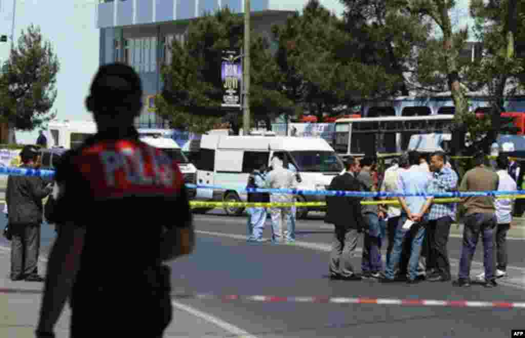 Security members and forensic experts work at the scene after a bomb exploded at a bus stop during rush hour in Istanbul, Turkey, Thursday, May 26, 2011. A bomb placed on a bicycle near a bus stop exploded during morning rush hour in Istanbul on Thursday,