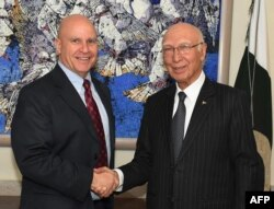 In this handout photograph released by the Press Information Department (PID) on April 17, 2017, Pakistan's National Security Advisor Sartaj Aziz (R) shakes hands with US National Security Adviser Lieutenant-General H.R. McMaster at the Foreign Ministry in Islamabad.