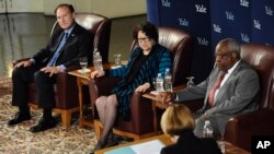 U.S. Supreme Court justices Samuel Alito, Jr., left, Sonia Sotomayor, second from left, and Clarence Thomas, second from right, listen to a question by law professor Kate Stith, right foreground, during a conversation at Yale University, in 2014. Thomas graduated from Yale Law School in 1974, Alito in 1975 and Sotomayor in 1979. The five other current Supreme Court justices all attended Harvard's law school, as did Donald Trump's nominee, Neil Gorsuch.(AP Photo/Jessica Hill)