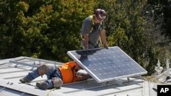 In this Oct. 16, 2015 file photo, a solar panel is installed on the roof of the Old Governor's Mansion State Historic Park in Sacramento, Calif. (AP Photo/Rich Pedroncelli, File)