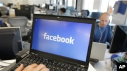 FILE - This photo shows a view inside Facebook headquarters in Menlo Park, Calif. Facebook announced Tuesday, Oct. 22, 2013, it was working on new ways to keep users from stumbling across gruesome content on its website following an outcry over the discovery of beheading videos there. (AP Photo)