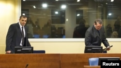 Bosnian Serbs Milan Lukic (L) and Sredoje Lukic (R) sit in the courtroom to attend the appeals verdict in their trial for war crimes in the former Yugoslavia, at the International Criminal Tribunal in The Hague, December 4, 2012.