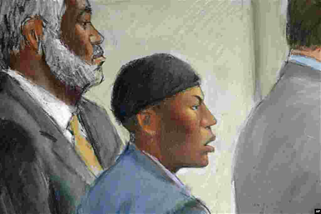 In this courtroom drawing, Umar Farouk Abdulmutallab (C) appears in U.S. District Judge Nancy Edmunds' courtroom in Detroit, Michigan, with Anthony Chambers, the lawyer who was assisting in his defense (L) and Assistant U.S. Attorney Jonathan Tukel (R), O