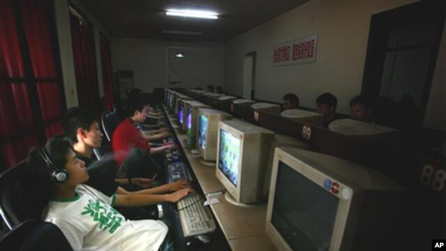 Chinese youths use computers at an internet cafe in Beijing, China, 2006 (FILE).