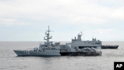 A Royal Malaysian Navy's missile corvette and an offshore patrol vessel in Straits of Malacca, Malaysia, March 13, 2014.