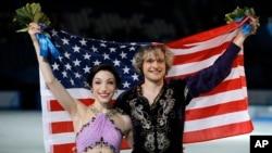 """Meryl Davis dan Charlie White memenangkan medali emas untuk nomor dansa gaya bebas """"figure-skating"""" Olimpiade Musim Dingin 2014 di Iceberg Skating Palace, Sochi, Rusia (17/2)."""