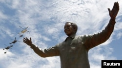 FILE - A bronze statue of late former South African President Nelson Mandela is seen in Pretoria, Dec. 16, 2013. A story in the British Sunday Times says the CIA helped South Africa's apartheid government arrest Nelson Mandela in 1962.