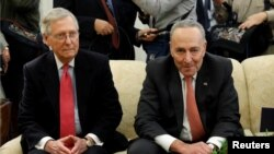 Senate Majority Leader Mitch McConnell and Senate Minority Leader Chuck Schumer take part in a meeting with U.S. President Donald Trump and other Congressional leaders in the Oval Office of the White House in Washington, Dec. 7, 2017.