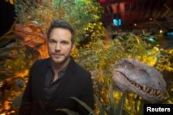 "FILE - Actor Chris Pratt, who plays raptor trainer Owen in ""Jurassic World"", poses at Universal Studios in Los Angeles, California, June 6, 2015."
