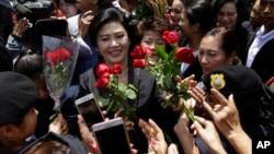 ဝန္ႀကီးခ်ဳပ္ေဟာင္း Yingluck Shinawatra တရားရံုးေရာက္ရွိ လာစဥ္။ ( ၾသဂုတ္လ ၁-၂၀၁၇)