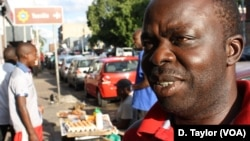 DRC soccer supporter Freddy Lendo in Rockey Street, Johannesburg, an epicenter of South Africa's large African immigrant community.