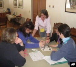 Lisa Purcell training parent volunteers to teach an elementary school workshop on owls.