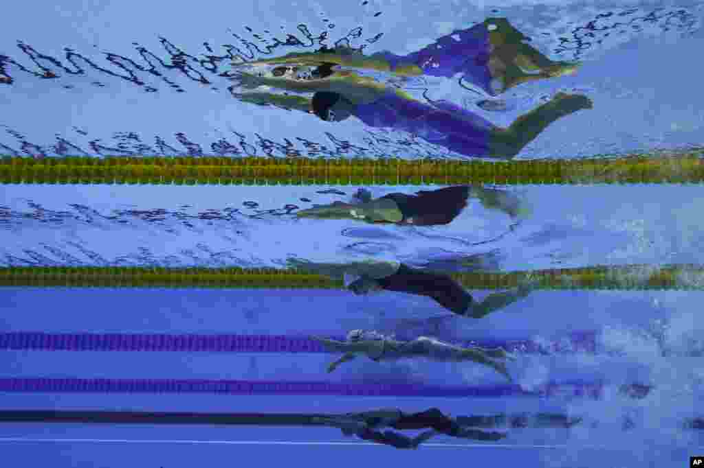 Swimmers from top to bottom; Uzbekistan's Shokhsanamkhon Toshpulatova, Ukraine's Anna Stetsenko, Poland's Joanna Mendak, Uzbekistan's Muslima Odilova and Fotimakhon Amilova compete in the Women's 100m Freestyle at the Paralympic Games in Rio de Janeiro, Brazil.
