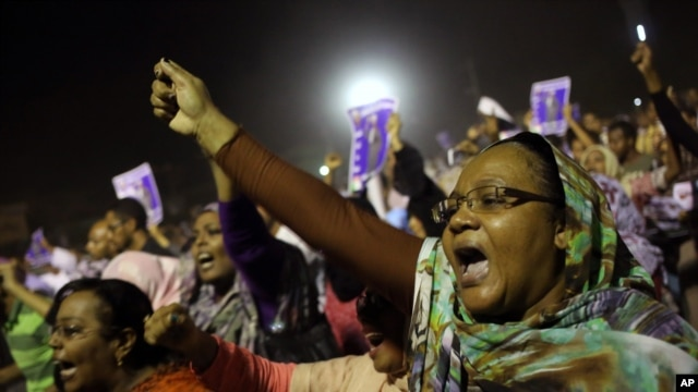 Sudanese anti-government protesters chant slogans during a demonstration in Khartoum, Sudan, Sunday, Sept. 29, 2013.