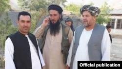 FILE - Mawlawi Habib Rahman, center, an Islamic State commander in northern Afghanistan, is seen in Jowzjan province.